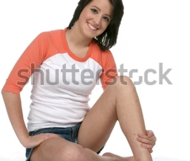 Pretty Teen With Bare Legs And Feet Sitting On A High Key Background