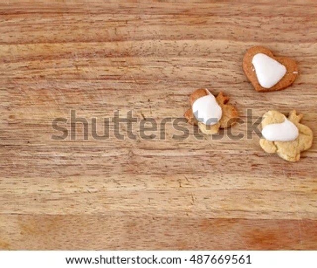 Rough Homemade Shaped Cookies With Glaze On Wooden Background Top View