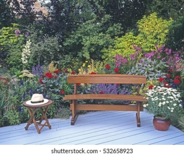 Seating Arrangement With Decking With A Colourful Flower Border