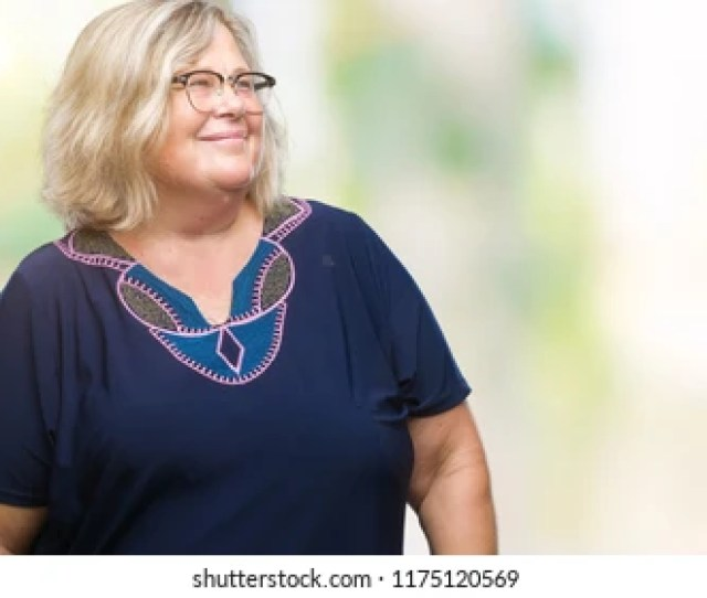 Senior Plus Size Caucasian Woman Wearing Glasses Over Isolated Background Looking Away To Side With Smile