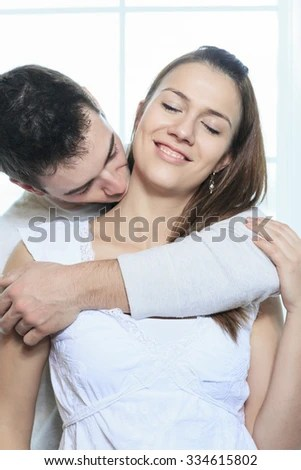 A Sensual Couple Having Great Time Close To The Window