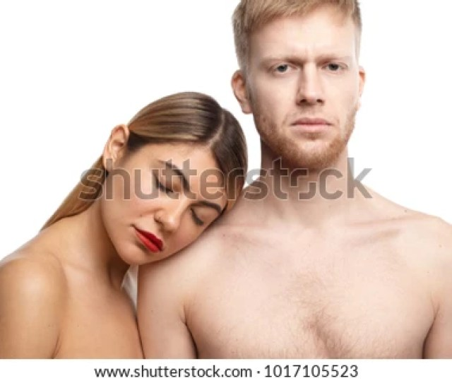 Sensual Passionate Adult Couple Posing Topless In Studio Handsome Unshaven Male Looking At Camera With
