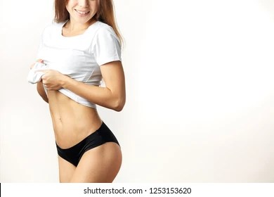 girl taking her shirt