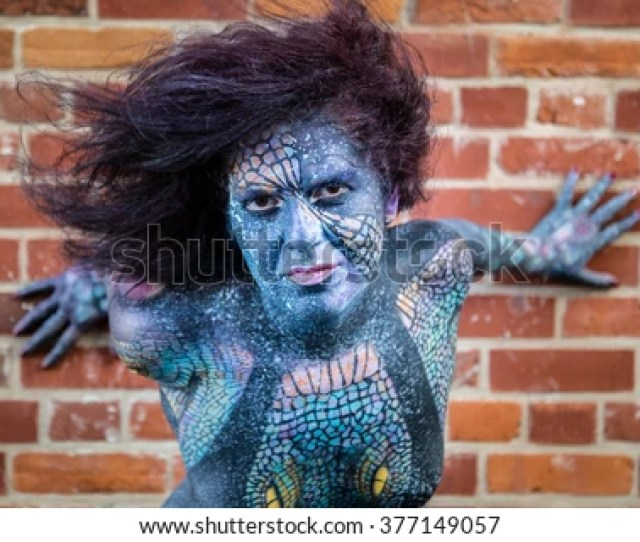 Sexy Hot Model In Body Paint With Blue Face