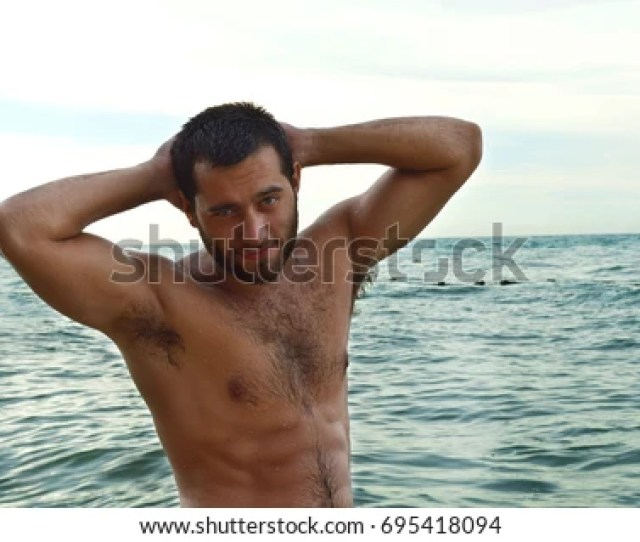 Sexy Muscular Handsome Man Standing On The Ocean Beach Hot Fitness Male Model Men Muscle