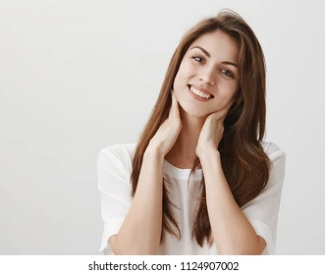 She Wants Boyfriend To Make Her Massage Portrait Of Charming Caucasian Girl Tilting And Smiling