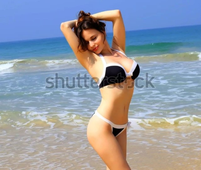 Slim Tanned Girl On The Beach
