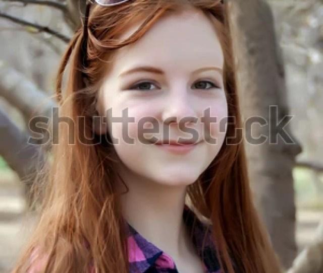 Smiling Red Hair Teen Girl In A Garden