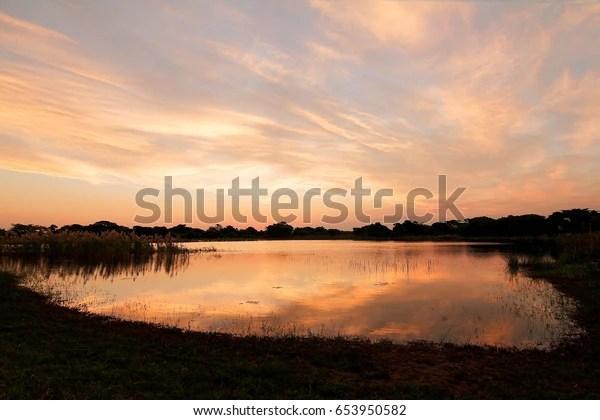 South African Dam Sunset On Bonamanzi Stock Photo Edit Now