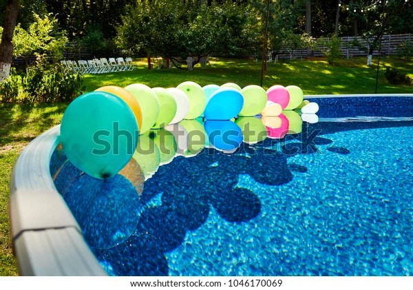 swimming pool colorful balloons