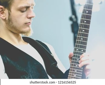 Teen Hardcore Man Wearing Metal Outfit Playing On Electric Guitar Heavy Rock Music