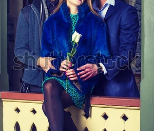 One Girl Holding A White Rose And Two Guys Hugging Her Are Looking