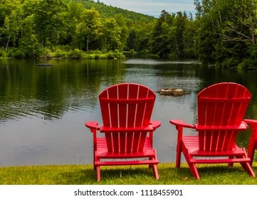 red adirondack chairs dining room chair pillows images stock photos vectors shutterstock two bright on the shoreline of lake in summer with a floating flower