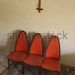 Chair Upside Down On Wall Graco High Straps Replacement Cross Above Stock Photo Edit Now 781631047 Three Orange Identical Chairs