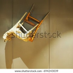 Chair Upside Down On Wall Discounted Office Chairs Upsidedown Attached Headwithhat Stock Photo Edit Now The With Head Hat Shadow
