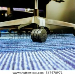 Swivel Chair On Carpet Leather And A Half Sleeper Wheel Floor Stock Photo Edit Now 567470971 Of The