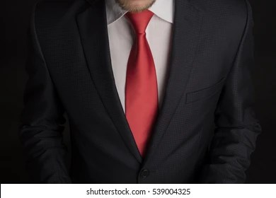 black suit red tie