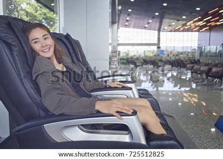 asian massage chairs z gallerie chair young female passenger relaxing stock photo edit now in the at airport women smilling