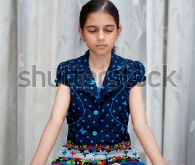 Young Indian Girl Or Kid Doing Yoga And Pranayam At Such An Early Age For A