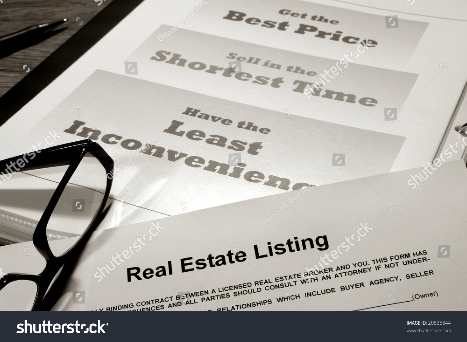 Real Estate Listing Contract Over Professional Realtor Agent Marketing And  Advertising Presentation Binder With House Sale