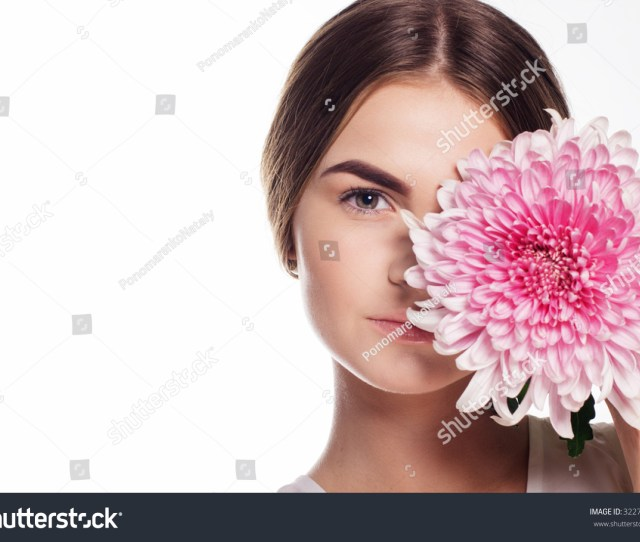 Portrait Of Pretty Young Teen Girl With Perfect Nude Makeup With Pink Chrysanthemum Flower Spa