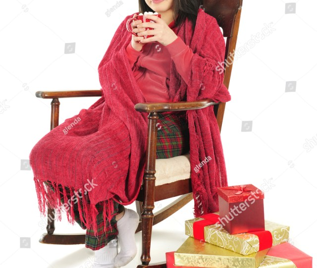 A Beautiful Teen Girl Sipping Hot Chocolate While Snuggled Up In A Red Blanket Christmas