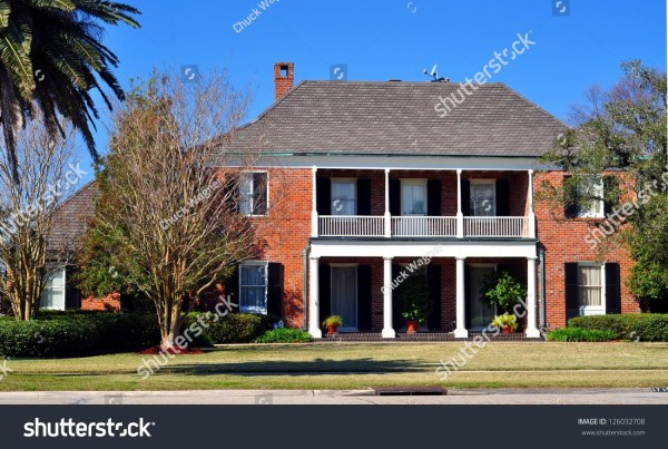 Beautiful Two Story Brick House Balcony Stock