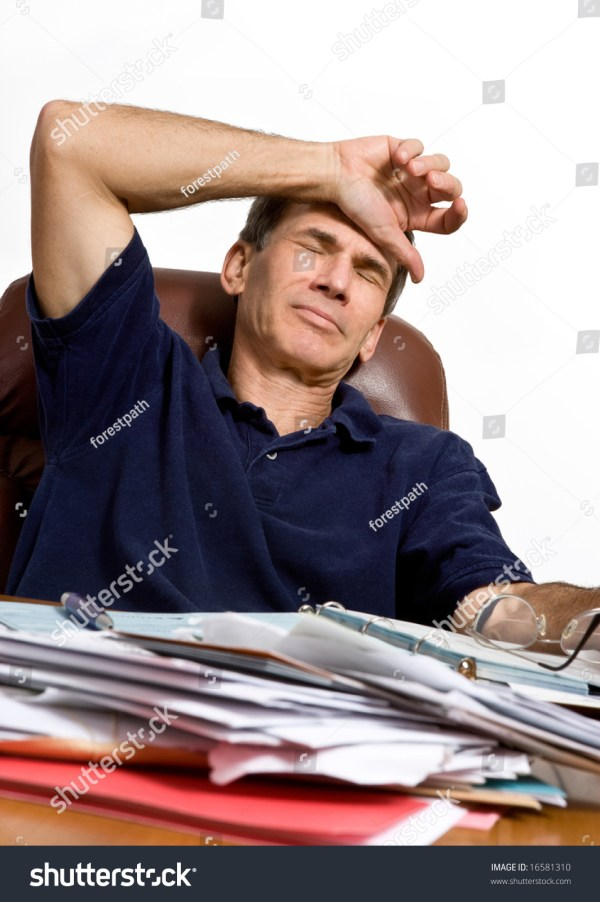 A Man At His Desk Worrying How He Will Pay The Bills Stock ...