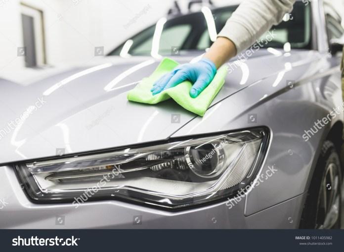 man cleaning car microfiber cloth car stock photo (edit now