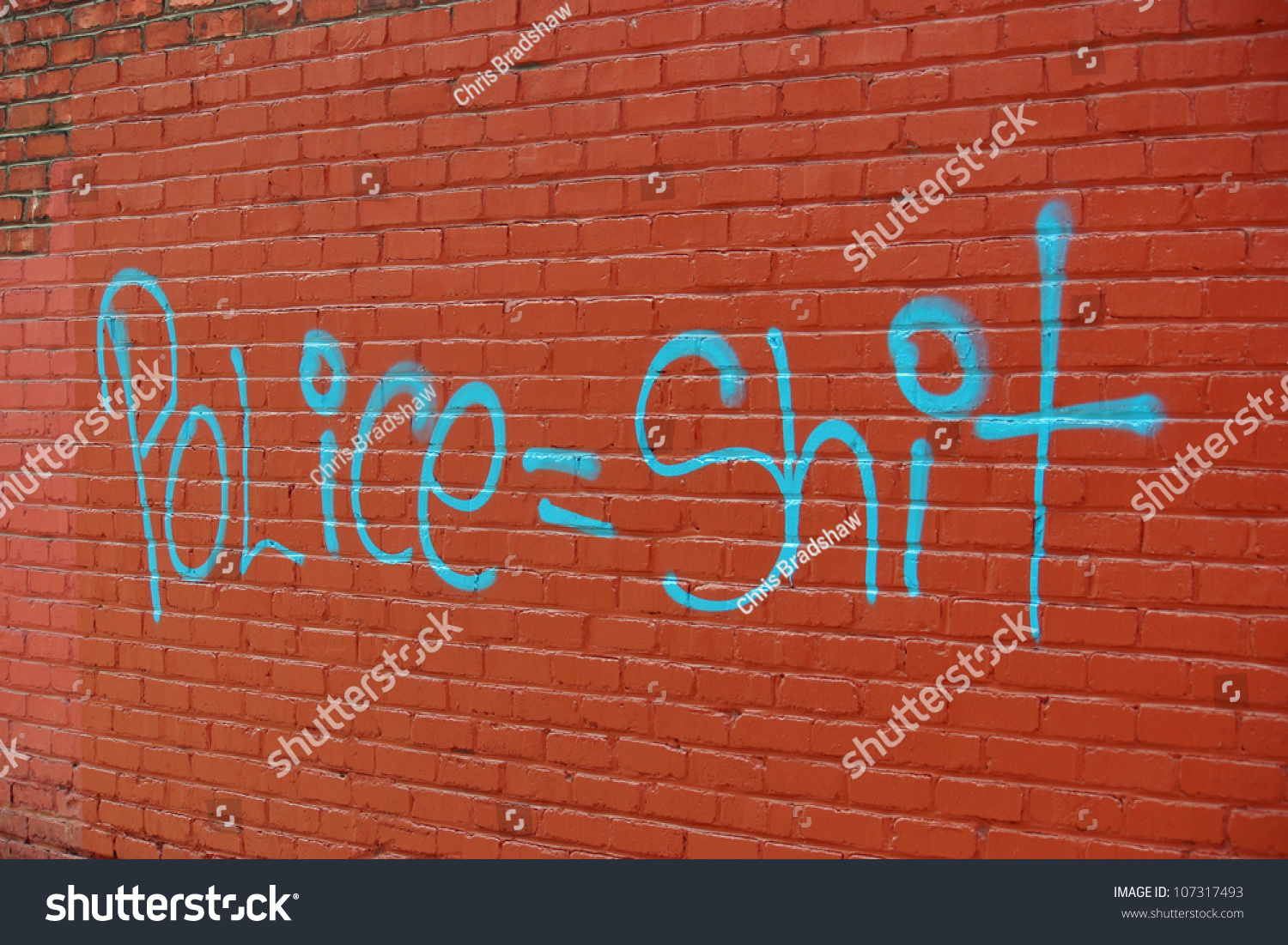 Red Brick Wall Graffiti Spray Painted Stock Photo