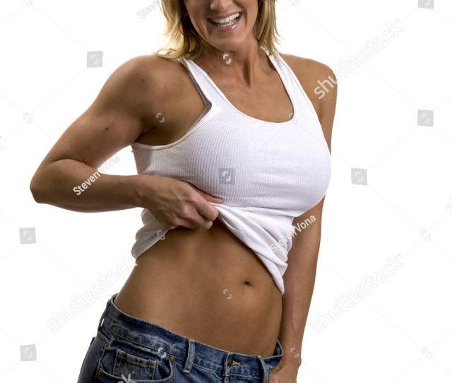 A Very Fit Mature Woman In A Tank Top And Jeans
