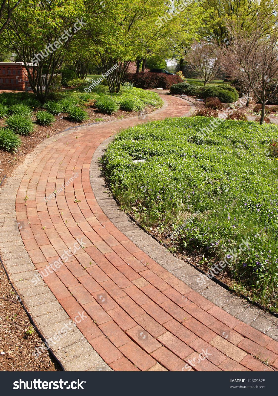 A Winding Brick Path In A Garden Stock Photo 12309625 : Shutterstock