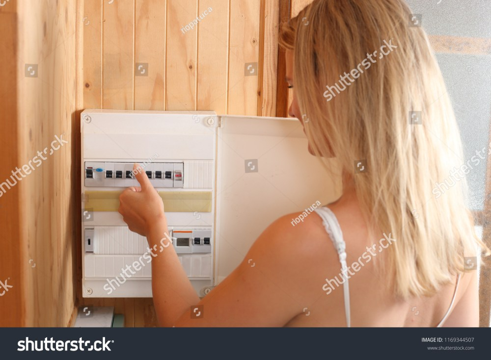 medium resolution of a woman switching fuses on a automatic fuse box