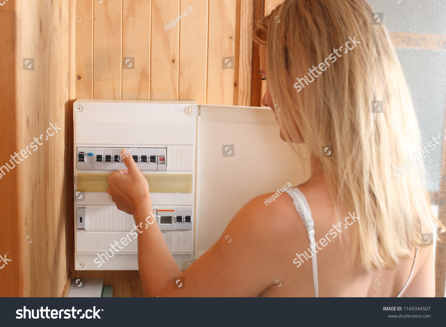 hight resolution of a woman switching fuses on a automatic fuse box
