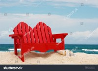 A Wooden Beach Chair Sitting On The Sand With Water, Beach ...