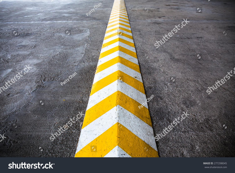 A Yellow Stripe Speed Ramp On Concrete Road. Stock Photo 277298045 : Shutterstock