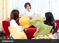 A Young People Talking In The Living Room Stock Photo
