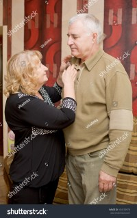 Adorable Amorous Happy Senior Couple Talking In The Living