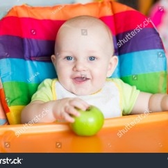 Baby Chairs For Eating Striped Wingback Chair Slipcover Adorable High Babys Stock Photo