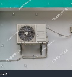 air condensing unit and ac disconnect box installed on wall outdoor [ 1500 x 1101 Pixel ]