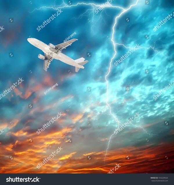 Aircraft Flying In Night Sky Of Lightning Stock