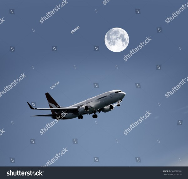 Airplane In Night Sky And Moon Stock 108732308