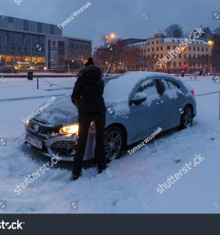 alesund norway january 06 2018 woman cleaning her honda civic from the [ 1500 x 1101 Pixel ]