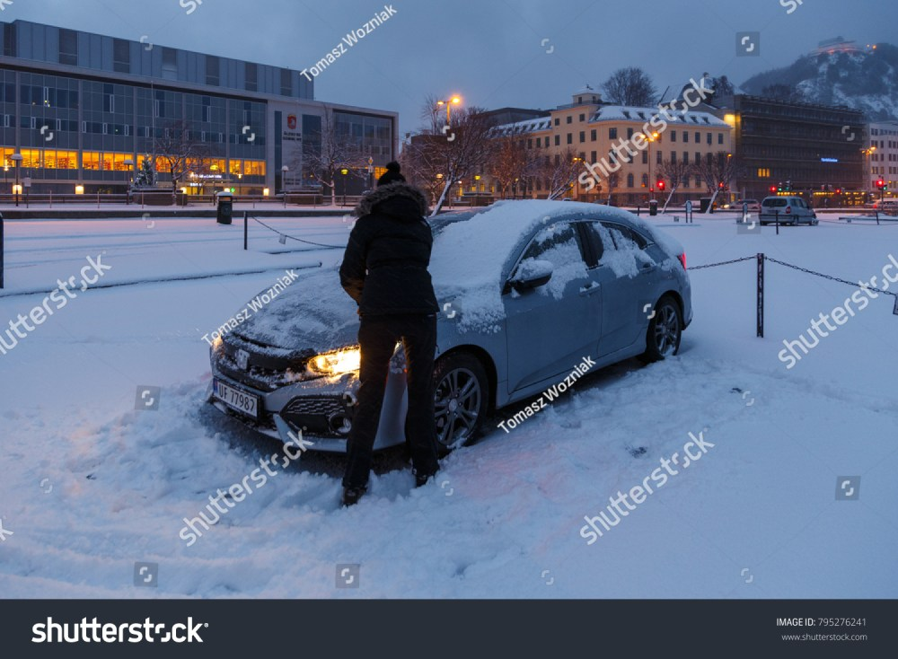 medium resolution of alesund norway january 06 2018 woman cleaning her honda civic from the