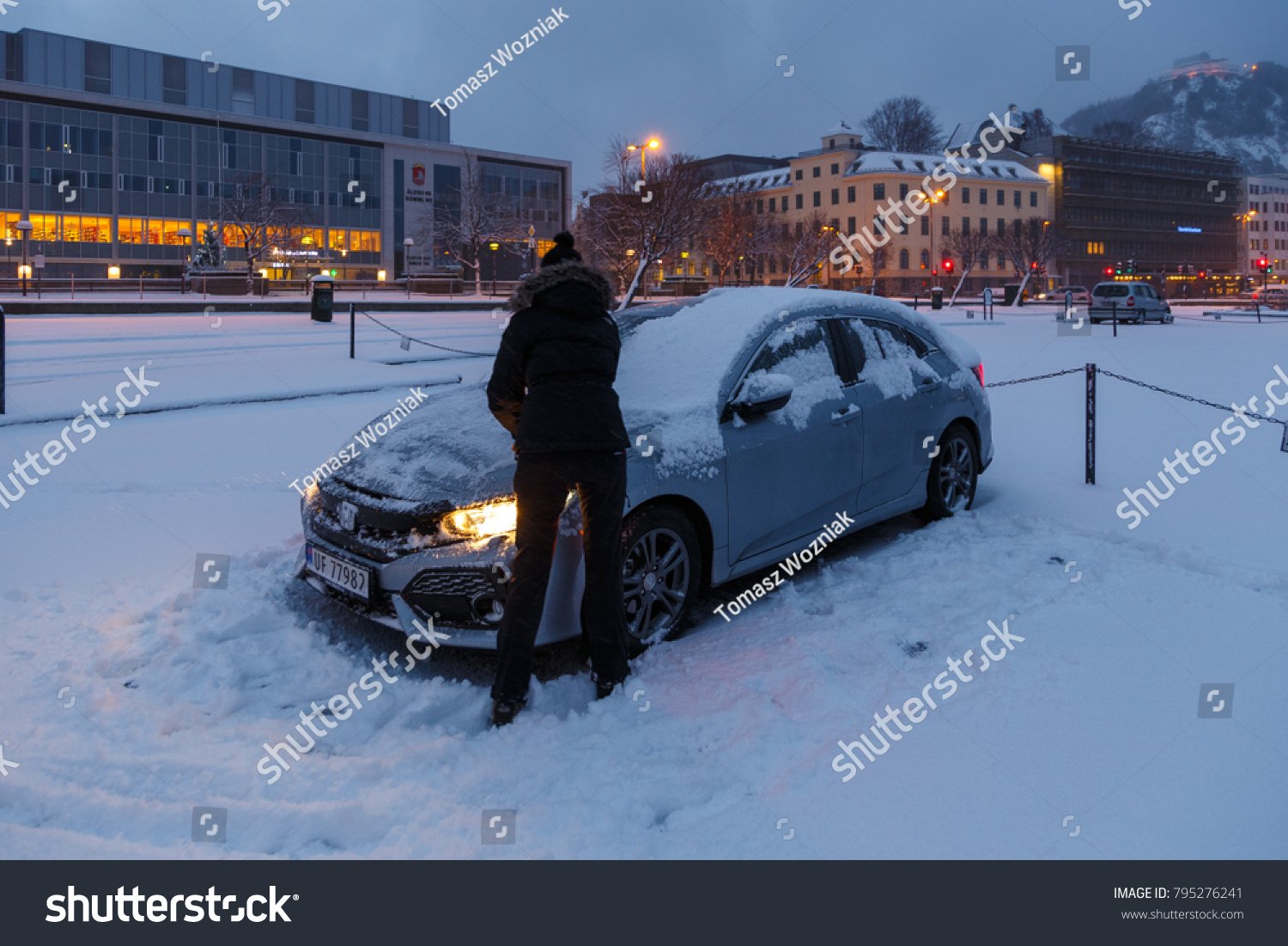 hight resolution of alesund norway january 06 2018 woman cleaning her honda civic from the