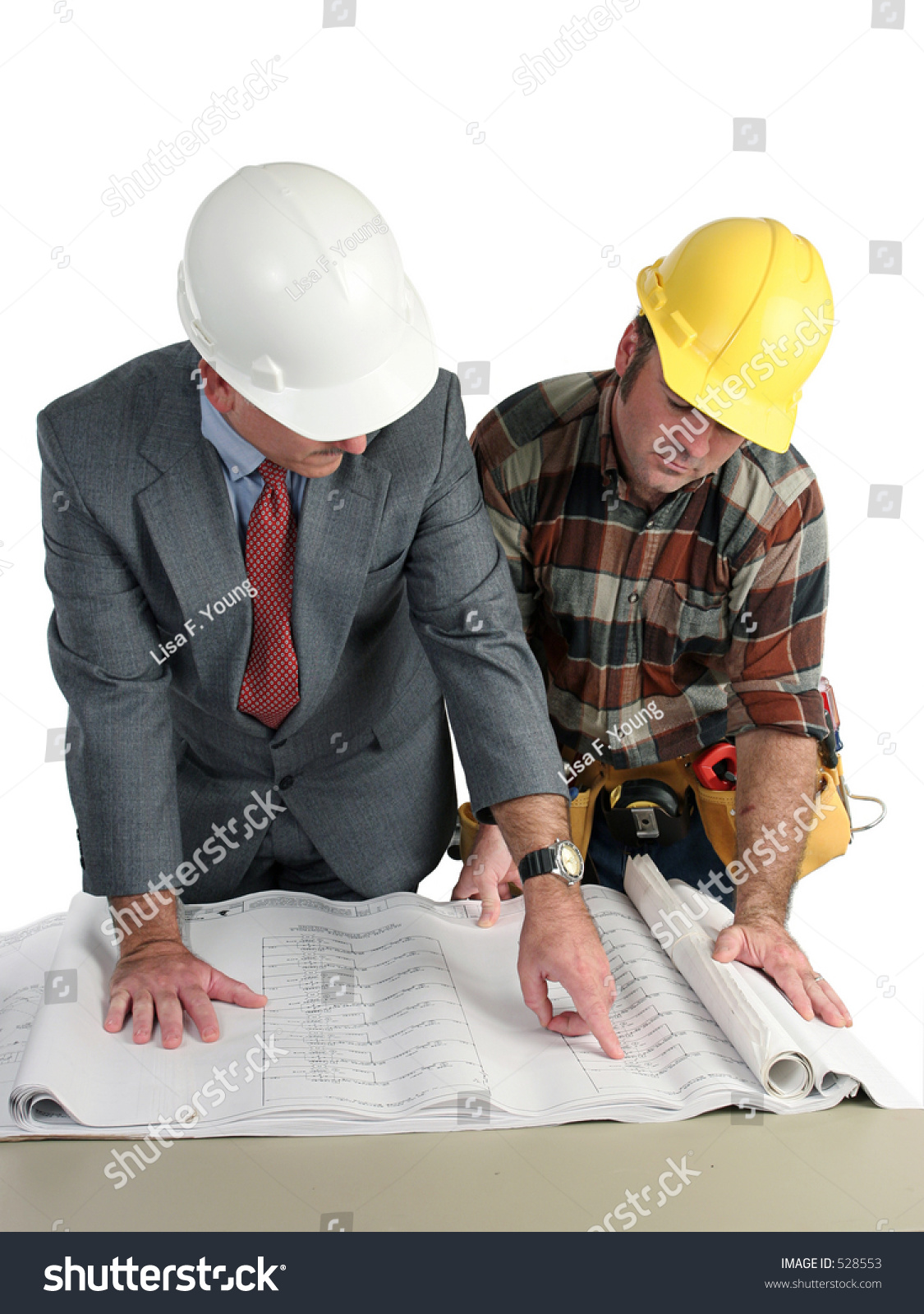 An Engineer And A Construction Foreman Reviewing Blueprints - Isolated Stock Photo 528553 : Shutterstock