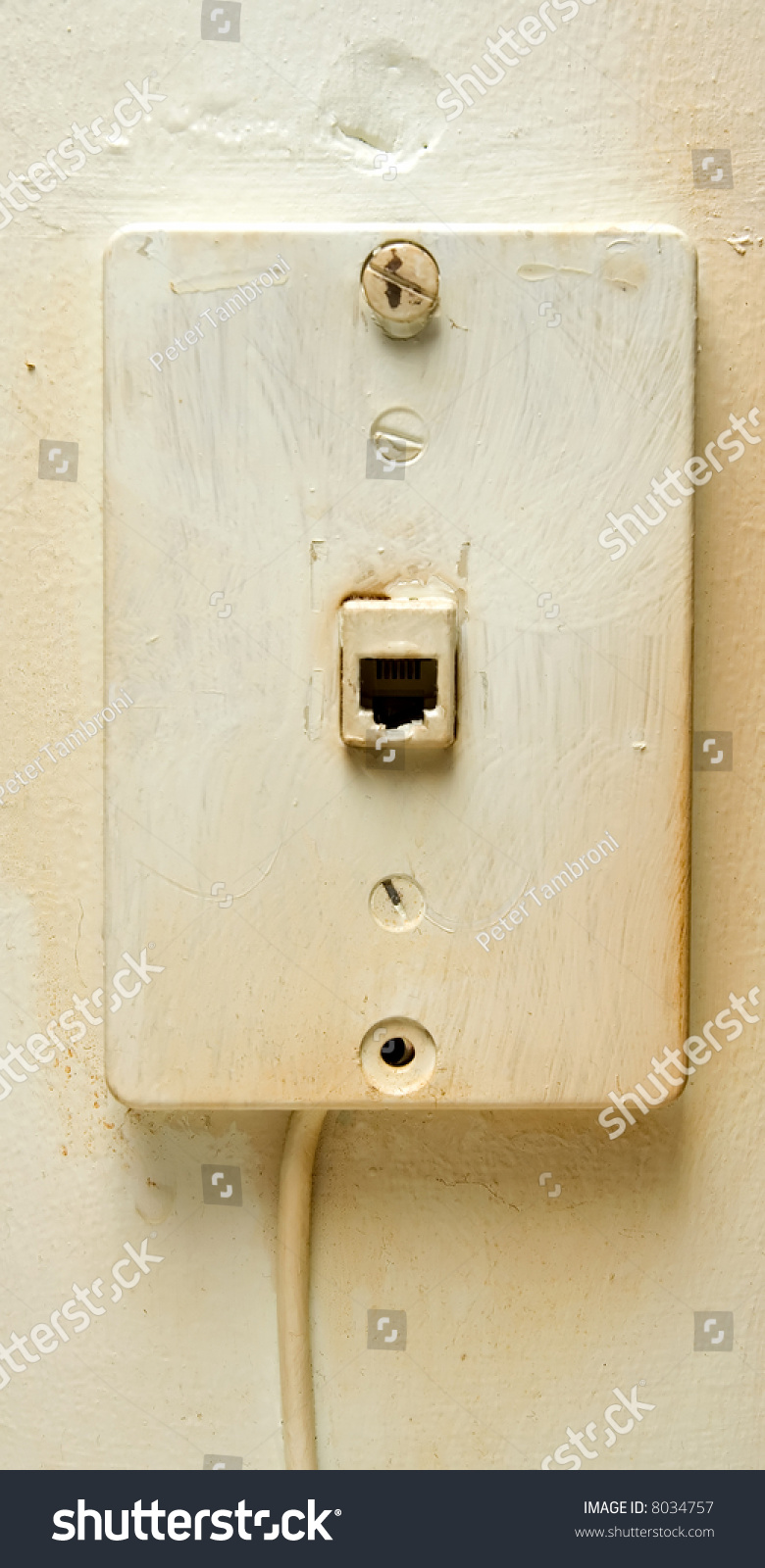 hight resolution of an old analog phone jack on a discolored wall
