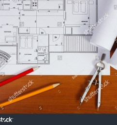 architectural plans pencils and ruler on the desk [ 1500 x 1101 Pixel ]