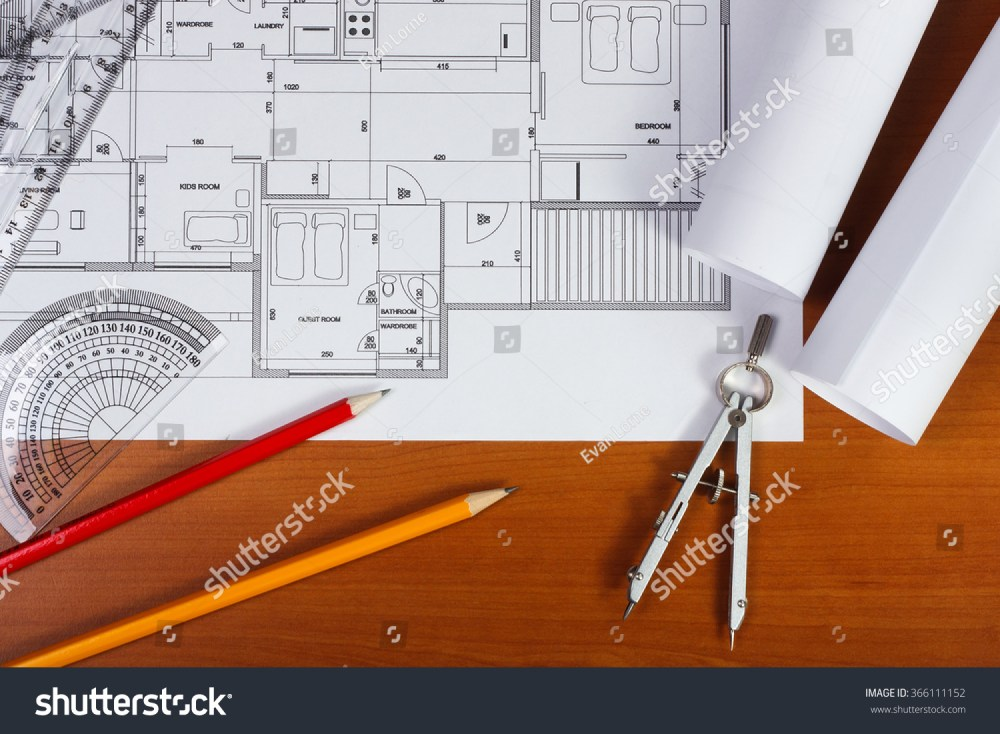 medium resolution of architectural plans pencils and ruler on the desk