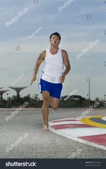 Asian Male Running Barefoot Track Stock 89414365